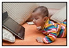 4th year Pic 095 - Mar 03 2012 admiring the iPad - 2nd Jan 2012 Every morning Swarup puts on nursery rhymes for Anika...